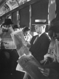 Commuters Sitting on a Train and Reading the Chicago Tribune