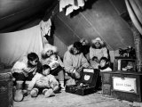Eskimo Family Admiring their Modern Conveniences  a Victrola  a Sewing Machine and a Stove