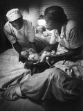 African American Midwife Maude Callen Delivering a Baby