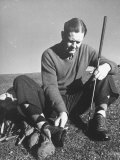 Golfer Byron Nelson Cleaning the Cleats on His Shoes