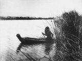 Pomo Indian Poling His Boat Made of Tule Rushes Through Shallows of Clear Lake  Northen California