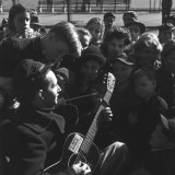 Folk Singer Woody Guthrie Playing Guitar for Group of Children