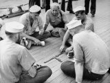 Sailors Aboard a Us Navy Cruiser at Sea Playing a Game of Dominoes on Deck During WWII