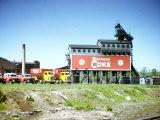 Photo Taken from Window of a Train Showing Coke Processing Plant Near Tracks