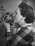 Mrs Martini  Wife of the Bronx Zoo Lion Keeper  Kissing a Tiger Cub