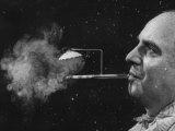 "President of Zeus Corp  Robert Stern  Smoking from Self-Designed ""Rainy Day"" Cigarette Holder"