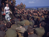 Uso Performer Entertaining a Crowd of Soldiers Aboard a Troop Transport Ship