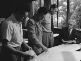 Architect Richard Neutra Going over Designs with Staff