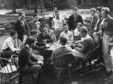 Members of the Throop Club Playing a Poker Game in the Courtyard of their Club Building