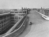 Fiat Car Driving Along the Desolate Street