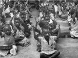 Children Raising their Hands in the Air During Kipuchi Kindergarten Classes