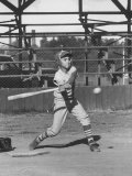 Young Boy Batting in Little League During Game