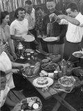 Young Married Couples Enjoying a Backyard Buffet Feast   Featuring Spaghetti