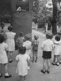 Kids Watching Outdoor Puppet Show