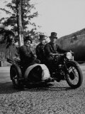 Three Chimney Sweeps Riding a Motorcycle