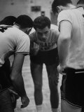 Basketball Player Tom Gola in a Huddle During a Basketball Game
