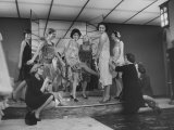 Women Trying on Costumes for the Roaring 20's Ball