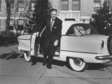 President of American Motors George W Romney Getting Out of His Car