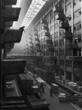 At Brooklyn Army Base Freight Is Lifted from Car to Jutting Loading Platforms