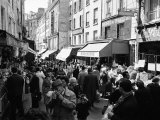 Crowded Parisan Street  Prob Rue Mouffetard  Filled with Small Shops and Many Shoppers