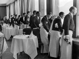 Waiters in the Grand Hotel Dining Room Lined Up at Window Watching Sonia Henie Ice Skating Outside