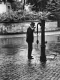Man Drinking from Public Water Pump Fountain on Street  Frankfort-On-The-Main  Germany