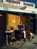 """Artist Ed Kienholz Drinking Coffee Inside Section of His Assemblage """"The Beanery """""""