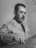 General Lazaro Cardenas  Pointing to a Map as His Continues to Work on a Stradegy