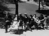 Jewish Families Sitting in the Sun During Visit to a Park