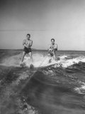 Two Men Behind Boat Which Is Not Seen  Water Skiing