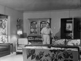 Gangster Mickey Cohen Standing in His Lavishly Furnished Living Room