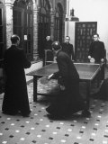 Priests Playing Ping-Pong at Social School Papier Photo par Dmitri Kessel