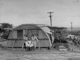 """Major Sidney Shelley and His Family Living in a """"Typhoonized"""" Quonset Hut"""