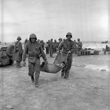 American Marines Carrying a Wounded Child to an Aid Station after the Invasion of Saipan