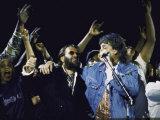 Former Beatles Ringo Starr and Paul Mccartney Performing
