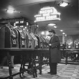 Man Playing the Slot Machines