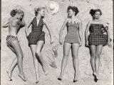Models Sunbathing  Wearing Latest Beach Fashions