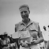 Freed American Pow Holding Red Cross Supplies after His Release from a Japanese Prison Camp