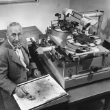 Astronomer Walter Baade Studying a Star Map