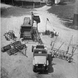 Farm Equipment Surrounding a Farmer's Jeep in Demonstration of Postwar Uses for Military Vehicles