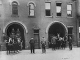 Firefighters Posing in Front of their Firehouse