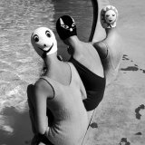Women Modeling Bathing Caps with Faces on Them Papier Photo par Ralph Crane