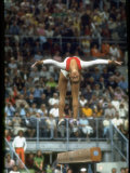 Soviet Gymnast Olga Korbut in Action on the Balance Beam at the Summer Olympics