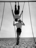 Acrobat and Actor  Russ Tamblyn on the Beach with Movie Actress Venetia Stevenson
