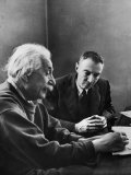 J Robert Oppenheimer  Dir of Institute of Advanced Study  Discussing with Dr Albert Einstein