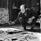 Painter Jackson Pollock Working in His Studio  Cigarette in Mouth  Dropping Paint onto Canvas