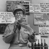 Comedian Phil Silvers Shuffling Cards on His Television Show