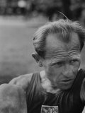 Emil Zatopek Sitting Tensely with Furrowed Brow after Winning Second of Three Olympic Races