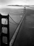 Car Lanes across the Golden Gate Bridge with Fog-Covered City of San Francisco in Background