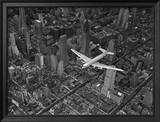 Aerial View of a Dc-4 Passenger Plane in Flight over Manhattan